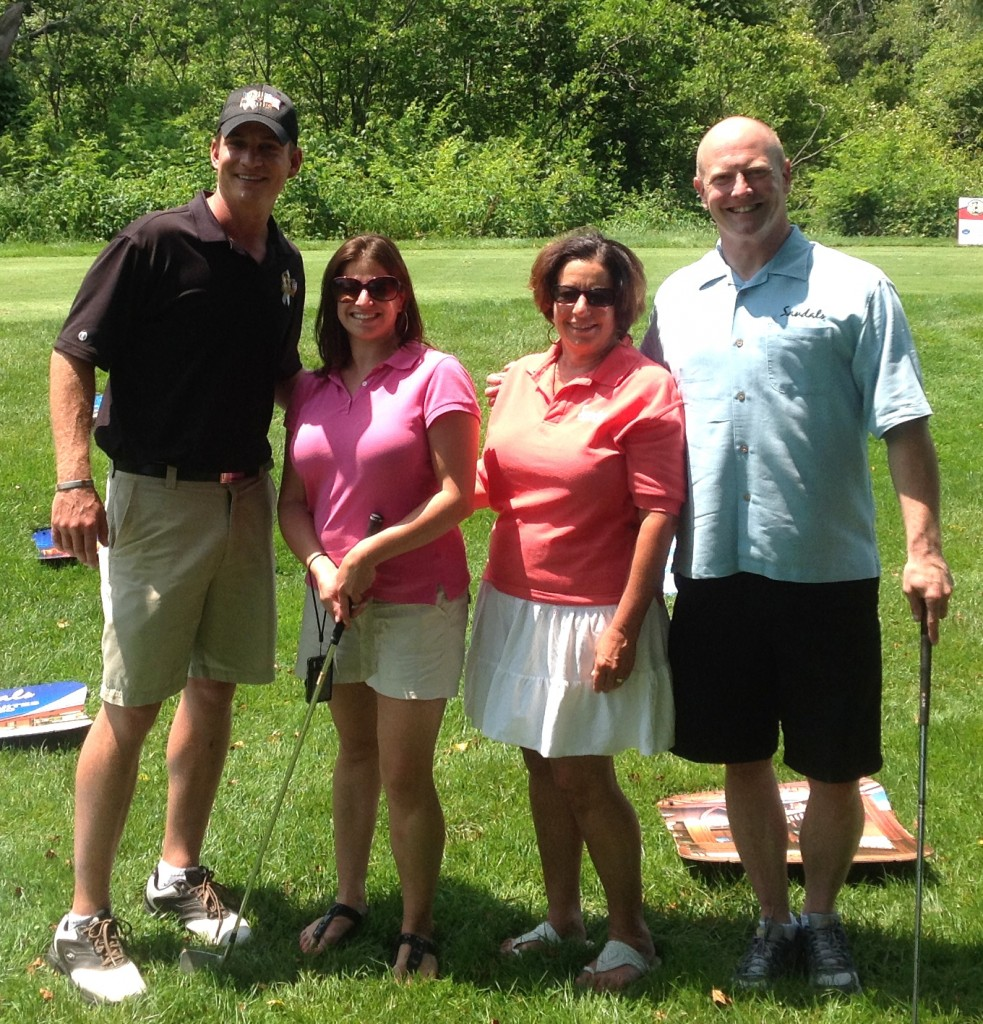 Pictured at the fourth hole of Ledgemont Country Club in Seekonk, MA. are, from left: Jeff Wells, President and Founder of WISH for OUR HEROES; Kim Paderson, Smiles & Miles Travel's Sales and Marketing Associate; Ellen Paderson, Founder/Owner of Smiles & Miles; and Kirk Olsen, Regional Business Development Manager for Sandals / Beaches Resorts.